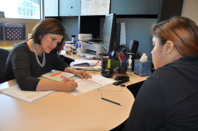 EOP&S Counselor Olga Morales-Anaya works with Jessica Medina, 21, in her office on an educational plan. Medina is prepared to transfer to San Jose State University next year