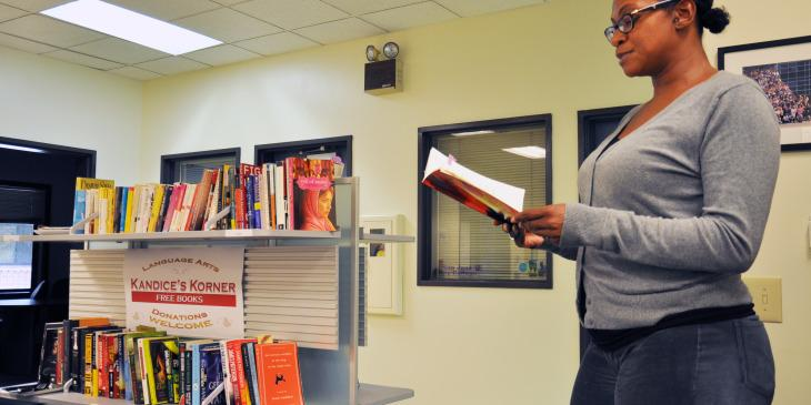 """Senior Administrative Assistant Julinda Le Dee read a small passage of her own poetry book, """"Rough Edges"""" at the small memorial reception in honor of her sister who passed away in the language arts department on Oct. 15."""