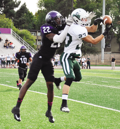 Holland Fisher, defensive back, blocks a passing attempt by Shasta College.
