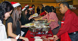 Holiday lunch serves up food and song