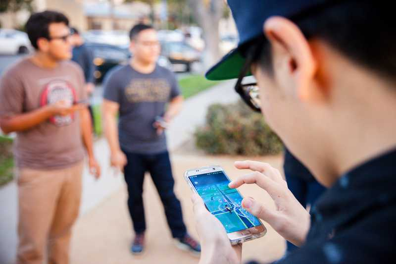 Students playing the top-grossing app of the year - Pokemon Go.