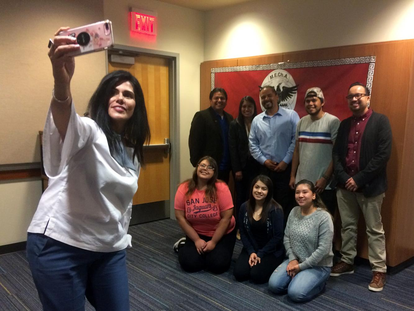 San Jose Vice Mayor Magdalena Carrasco poses for a selfie with students and faculty members of Movimiento Estudantil Chicano de Aztlan, who organized her speech on campus on Oct. 12 to honor Latino Heritage Month.