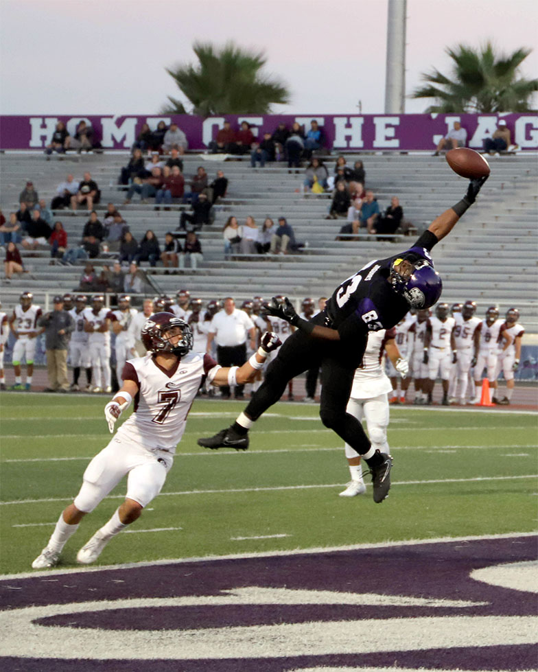 Jaguars WR Nathaniel Strong (83) makes an acrobatic catch over DB Anthony Saavedra (7) during the first quarter to give San Jose City College the early lead 6-0 againts visiting Monterey Peninsula College Saturday, Sept 16.