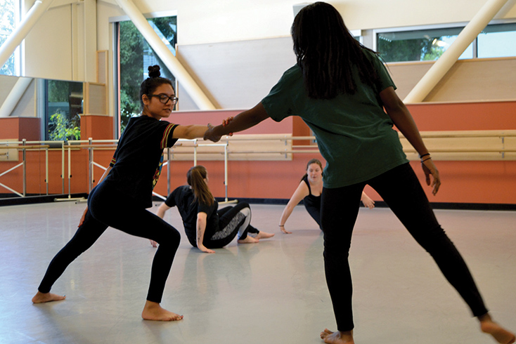Angel Canas and Mariah lock hands during their dance rehearsal led by student choreographer Tara Franklin on Wednesday, Nov. 1.