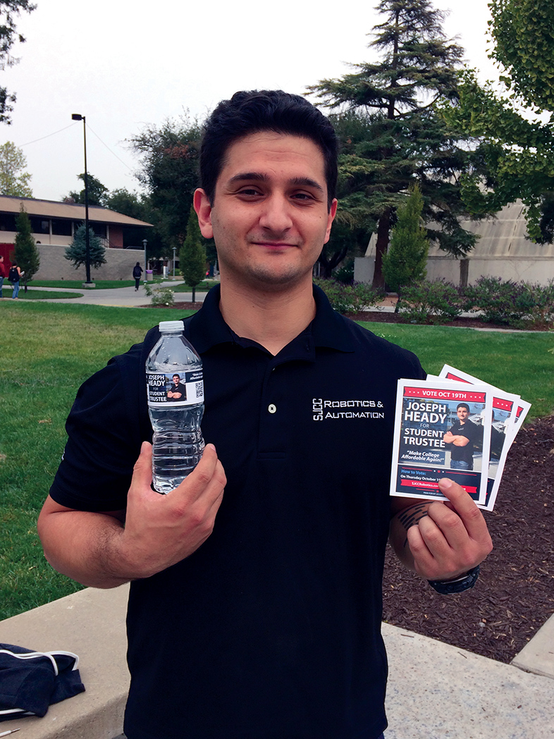 Joseph Heady, new student trustee of SJCC, displays his campaign materials in front of the Business Building on Tuesday, Oct. 17.