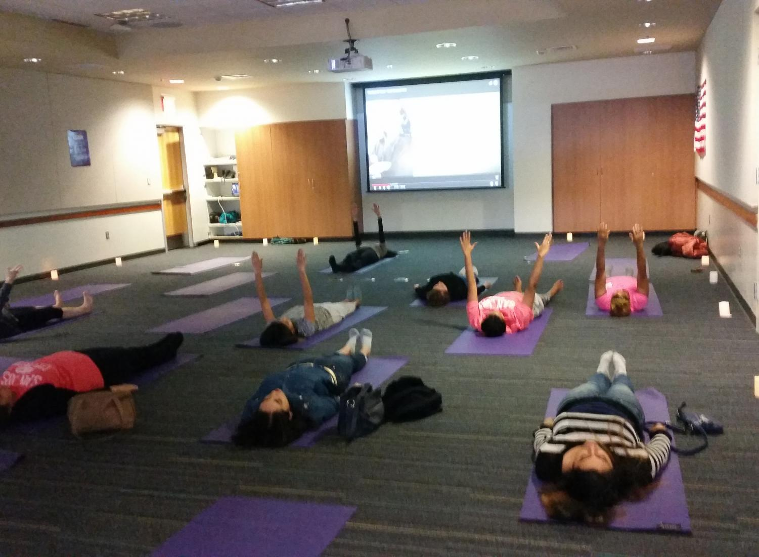 Students practice relaxing with yoga at Early Childhood Education's Go Go Stress event on Dec. 16, 2017.