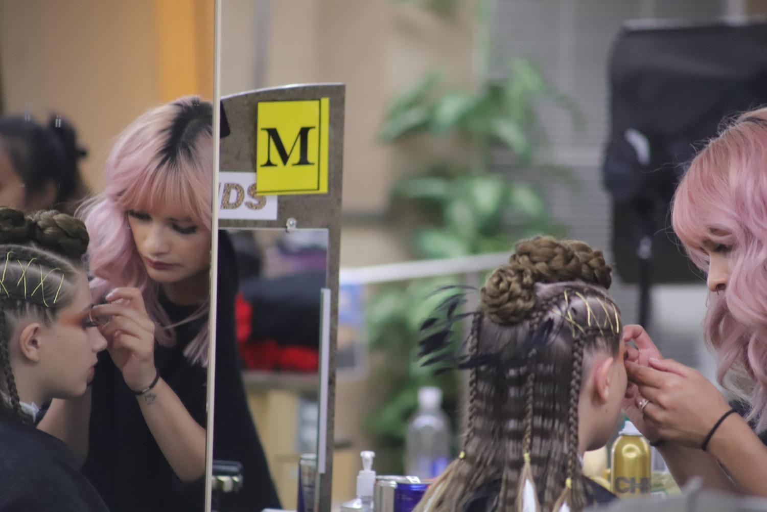 Freshman+technician+Layla+Ojeda+applies+makeup+to+her+model+Emily+Sonner+during+the+2018+Cosmetology+Spring+Hair+Competition+held+in+the+cosmetology+building+at+SJCC+on+Friday%2C+April+27.+Ojeda+and+Sonner+placed+Second+in+%E2%80%9CMakeup%2C%E2%80%9D+First+in+%E2%80%9CHair%E2%80%9D+and+Second+in+the+%E2%80%9CTotal+Look%E2%80%9D+categories+at+the+Spring+Hair+show+held+at+The+Glasshouse+later+that+night.