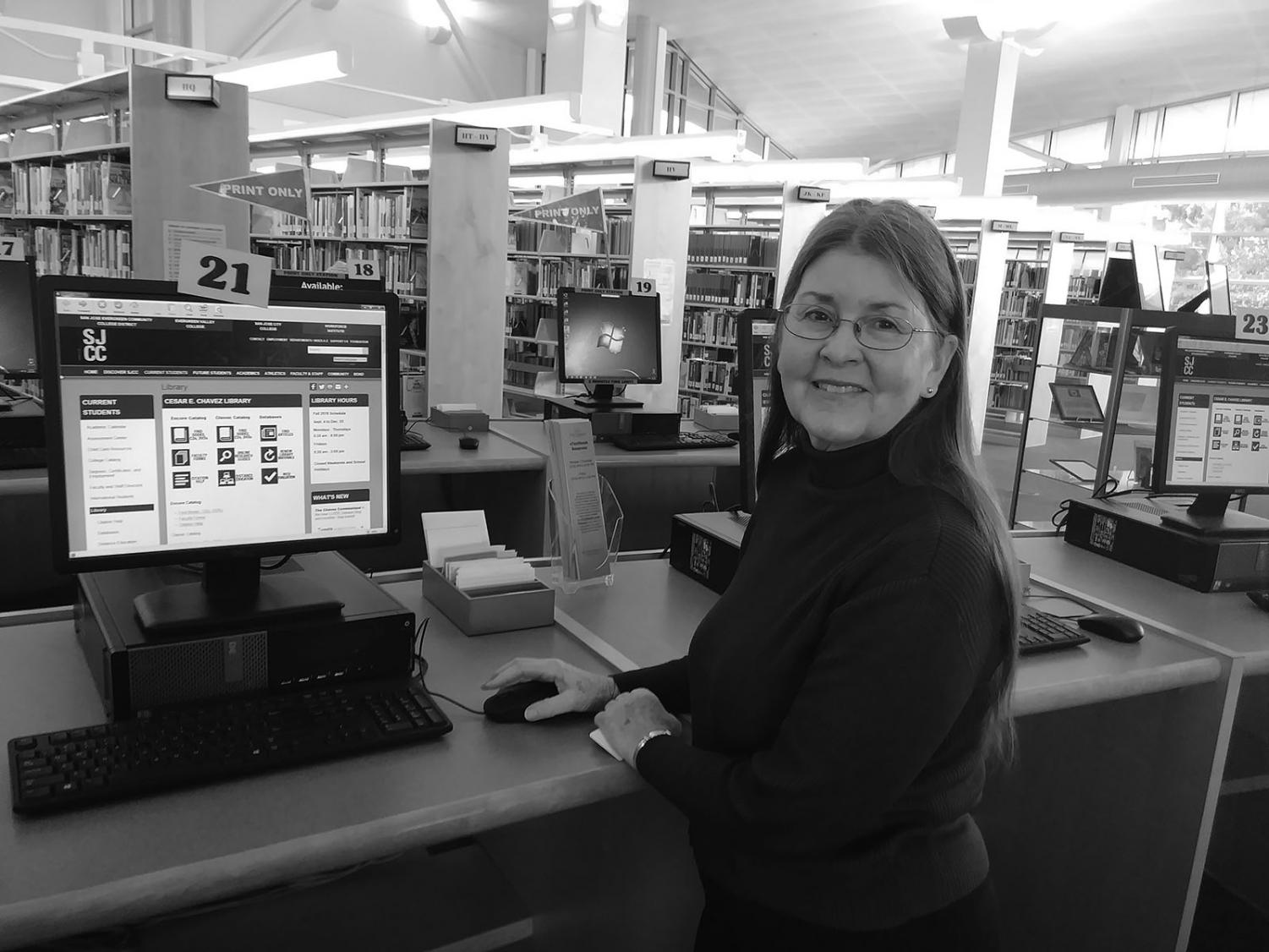Librarian Linda Meyer shows the resources on the library's website, Dec 11. Meyer advised students to visit the library home page, before searching on Google. PHOTO BY KAYNE GALLEGOS TIMES STAFF