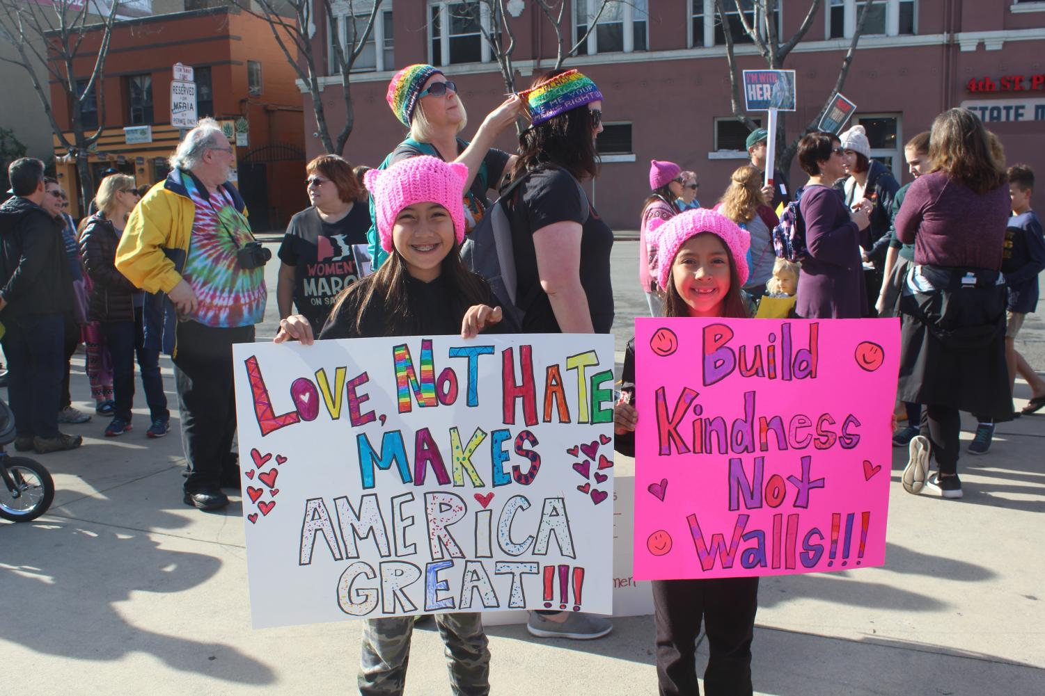 By Zoe Goddard, Girls proudly show off their homemade signs