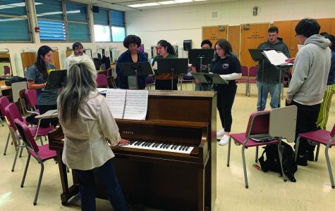 Cast members warm up for rehersal in the theatre building, Oct. 3.