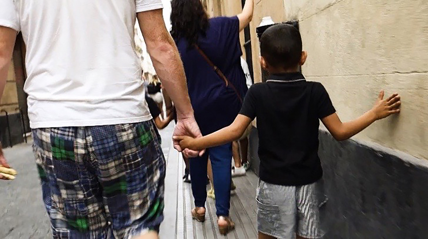 One of the team members holds hands with one of the refugee's children in Cadiz, Andalueia, Spain.