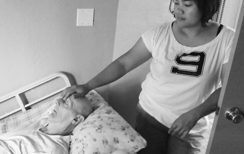 Fe Hilario checks on a sleeping Franklin Hill at the Magdalene House in Sunnyvale, California.  The care home caters to six senior residents who require 24-hour care.