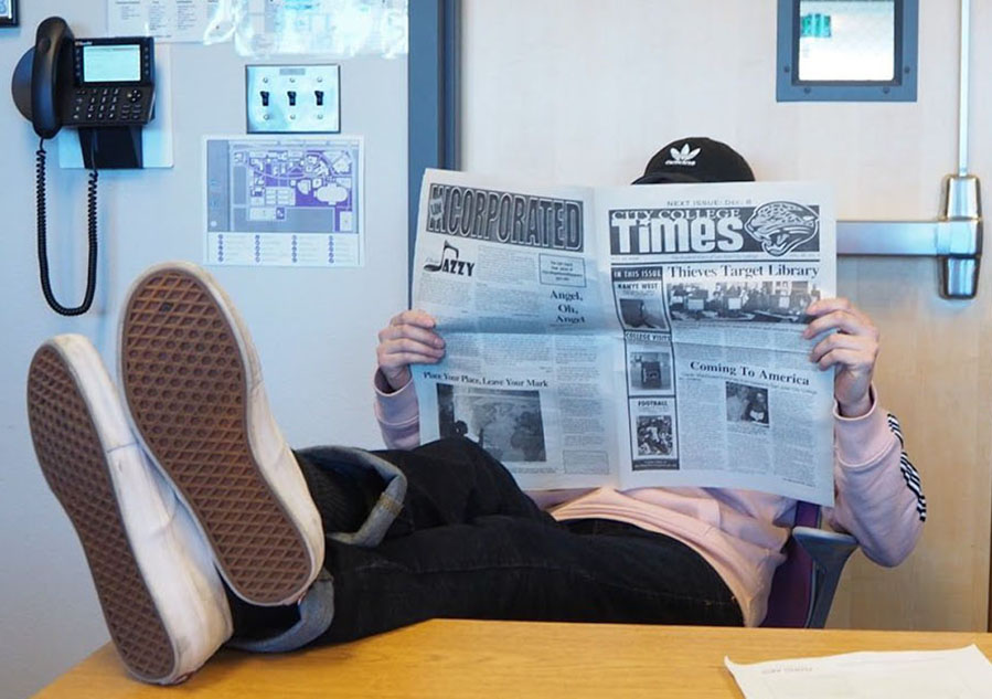 City+College+Times+Editor-in-Chief+Jasper+Somera+relaxes+in+the+newsroom+with+a+copy+of+the+City+College+Times+newspaper.