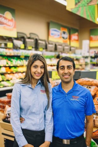 Avez and Alia Bashadi pose inside their store, South San Jose Grocery Outlet.