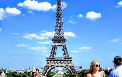 Tourists take in the Eiffel Tower