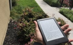 City College Times staff member Anton Vladimir heads to the garden to read with a Kindle e-reader.