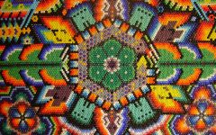 This beaded art peyote flower is an example of traditional Huichole folk art.