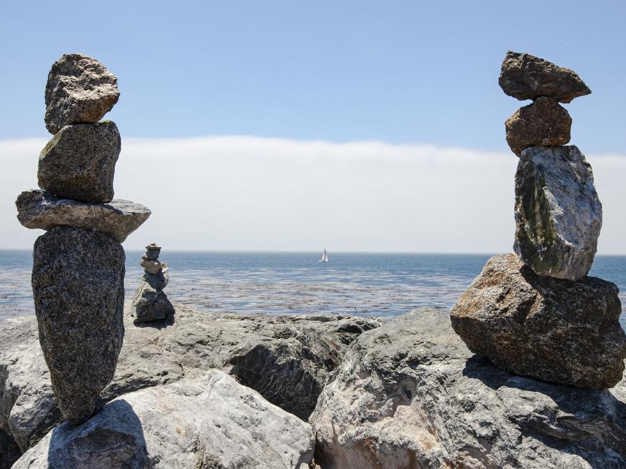 Zen balance rocks line the cliffs near Westcliff Drive in Santa Cruz, California..
