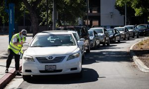 Cars line up at the San Jose City College campus grocery giveaway on July 8. SJCC in partnership with Second Harvest Food Bank hosted the food distribution event and gave out over 10 tons of food.