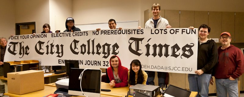 Archive photo: San Jose City College Times staff hold the publication banner in the newsroom December 2012.