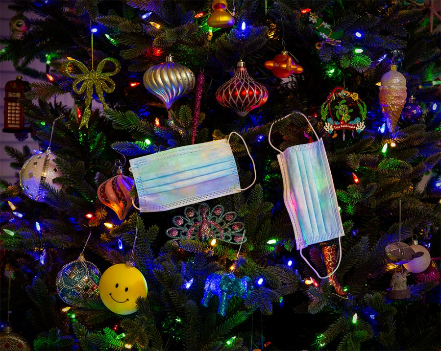 Face masks are used as ornaments on a Christmas tree in Santa Cruz, California, on December 12.