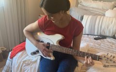 Isabella Morrison, a 18-year-old student at Milpitas High School and San Jose City College, playing her electric guitar in her bedroom, Wednesday, September 9, 2020.