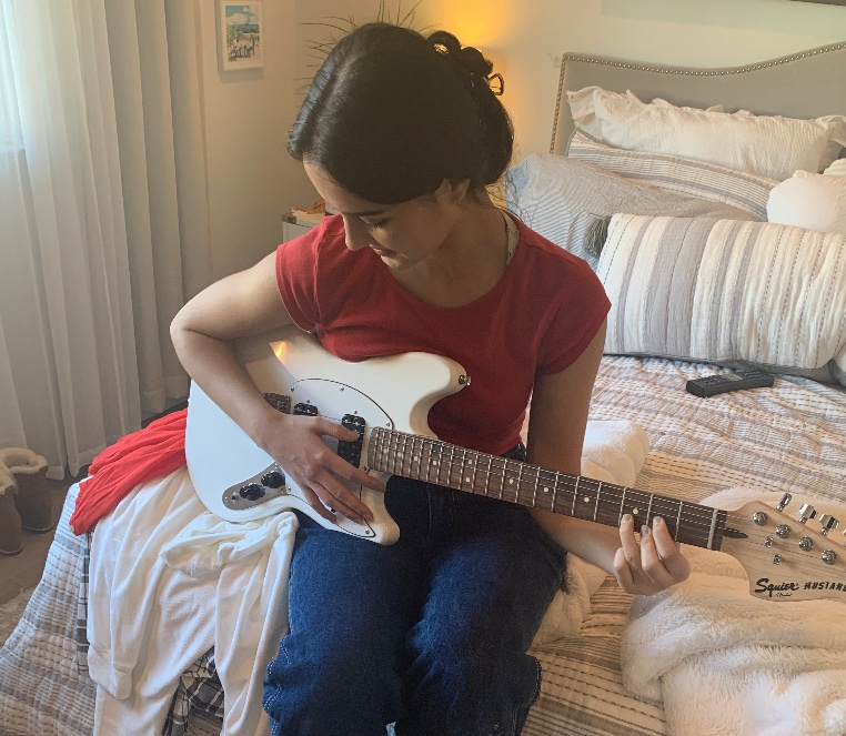 Isabella+Morrison%2C+a+18-year-old+student+at+Milpitas+High+School+and+San+Jose+City+College%2C+playing+her+electric+guitar+in+her+bedroom%2C+Wednesday%2C+September+9%2C+2020.