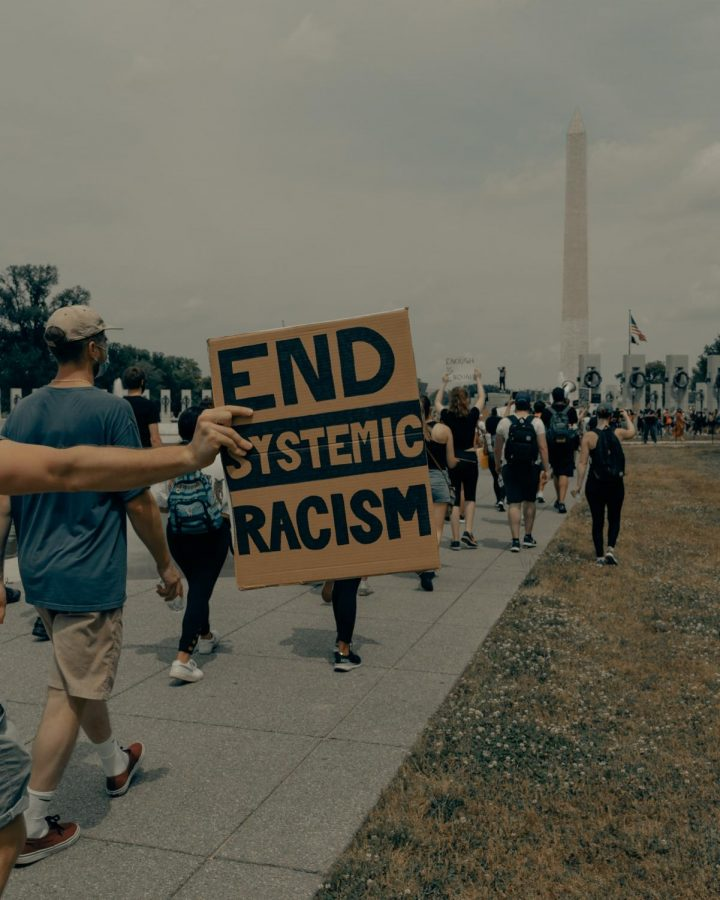 People march towards the Washington Monument at the Black Lives Matter protest in Washington, D.C.  Photo by Clay Banks on Unsplash